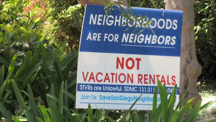 Signs like this one can be spotted on front lawns and porches throughout San Diego.