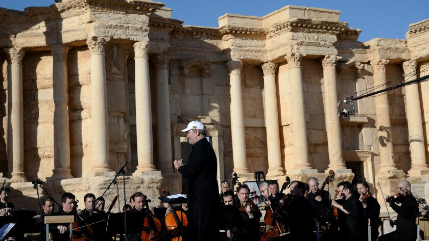 The Mariinsky Symphony Orchestra performs in the Roman theater in Palmyra, Syria.