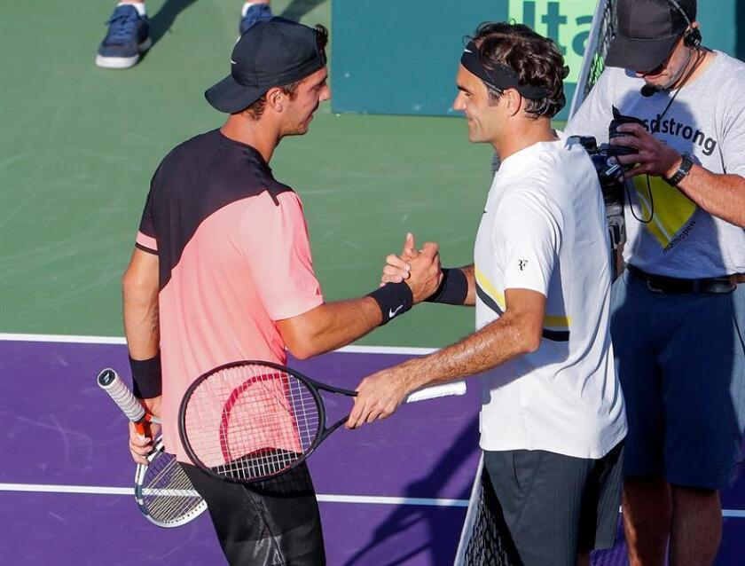 Thanasi Kokkinakis (L) of Australia is greeted by Roger Federer (R) of Switzerland after Kokkinakis defeated Federer during a second round match at the Miami Open tennis tournament on Key Biscayne, Miami, Florida. EFE