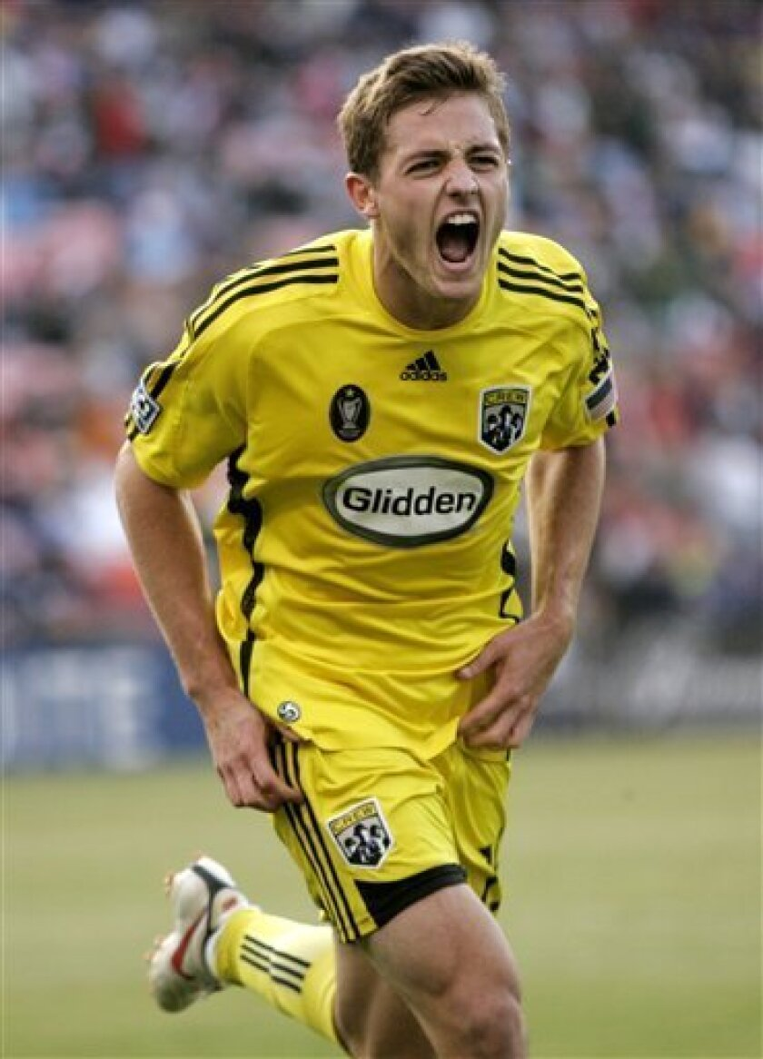 FILE - In this Aug, 8, 2009 file photo, Columbus Crew's Robbie Rogers celebrates after scoring against the San Jose Earthquakes during the second half of an MLS soccer match in San Francisco. Former MLS and U.S. national team player Robbie Rogers says he is gay. In a post on his personal website, R