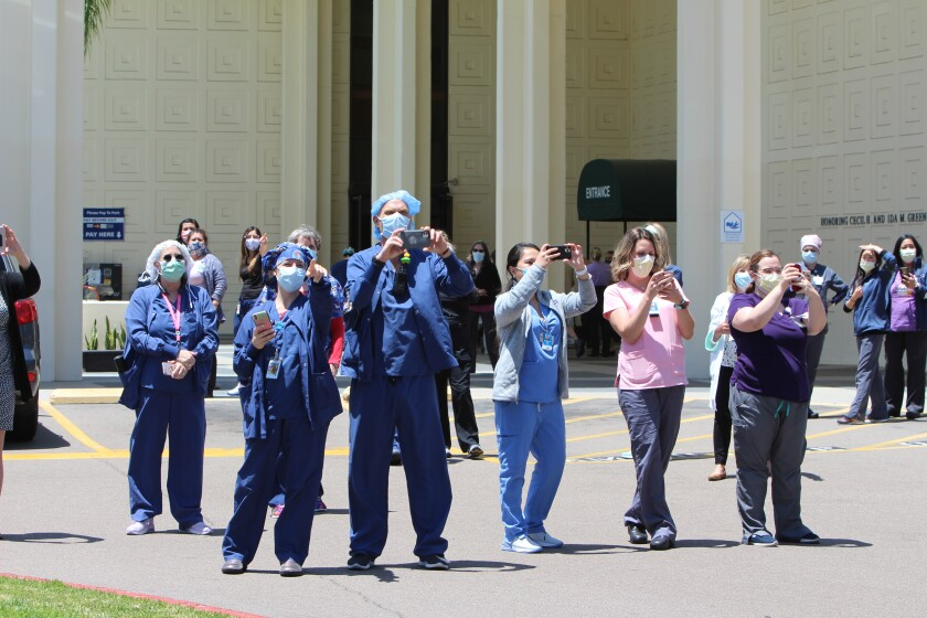 Staff members at Scripps Green Hospital watch and photograph a flyover by Air Force Thunderbirds on May 15.