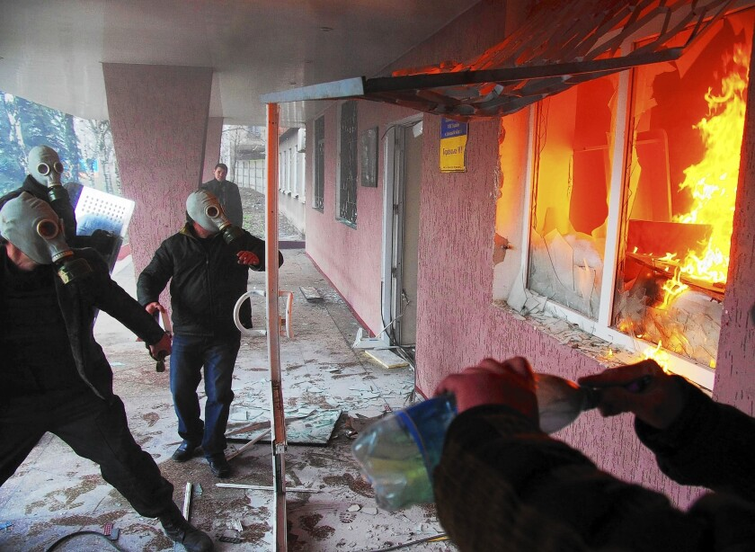 Pro-Russia protesters attack a regional police building in Horlivka, in eastern Ukraine.