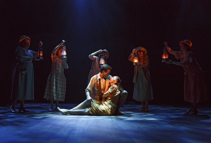 """Wayne Alan Wilcox and Carmen Cusack (center) with """"Bright Star"""" cast members in a scene from the world-premiere musical at the Old Globe Theatre."""