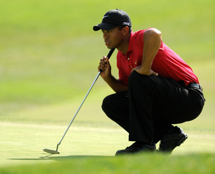 Tiger Woods lines up a putt during his victory over Rocco Mediate at the U.S. Open in 2008.