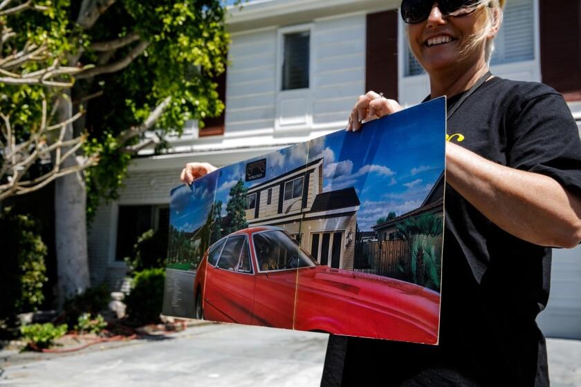 DOWNEY, CALIF. -- THURSDAY, APRIL 25, 2019: Toni Lee, from Kent, U.K., holds up an album art feature