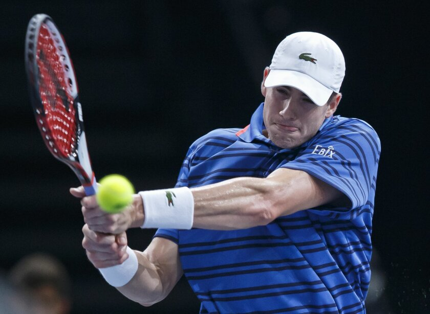 John Isner of the U.S. returns the ball to David Ferrer of Spain during their quarterfinal match of the BNP Masters tennis tournament at the Paris Bercy Arena, in Paris, France, Friday, Nov. 6, 2015. (AP Photo/Michel Euler)