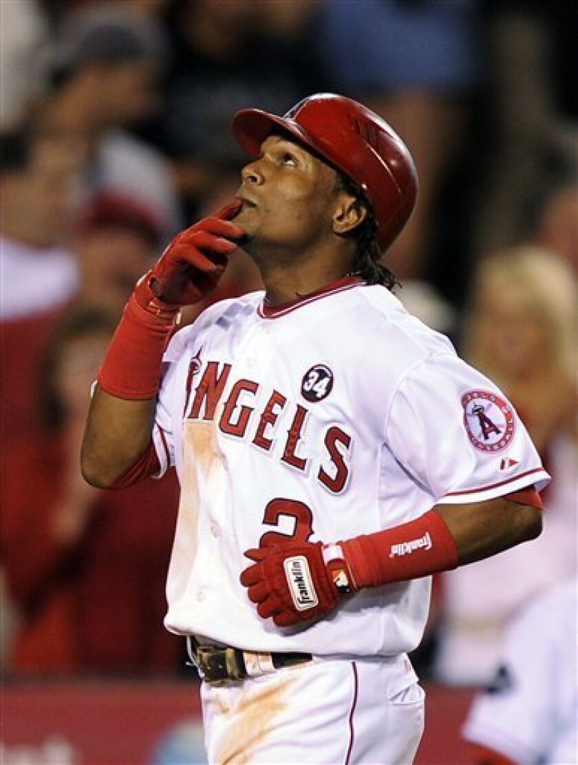 Los Angeles Angels' Erick Aybar kisses his hand as he looks to the sky after hitting a three-run home run during the seventh inning of their Major League Baseball game against the New York Yankees, Friday, July 10, 2009, in Anaheim, Calif. (AP Photo/Mark J. Terrill)