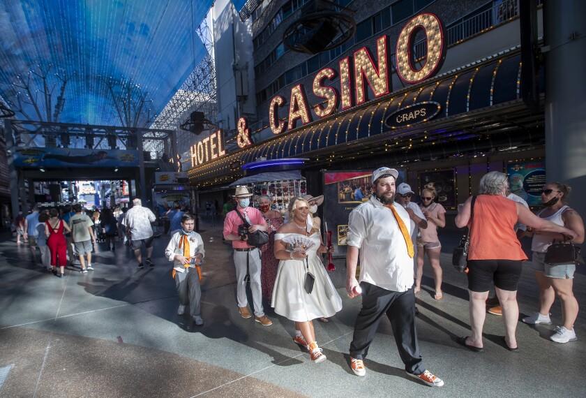 Tourists walk along Fremont Street in downtown Las Vegas.