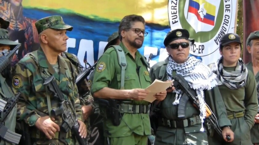 Former Revolutionary Armed Forces of Colombia commander Ivan Marquez, center, said in a recent video message that he would fight the government for better conditions for ex-combatants.