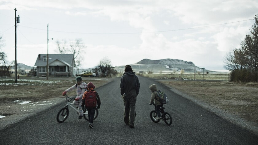 David (Clayne Crawford) walks along an empty town road with his three young sons, two of them on bikes