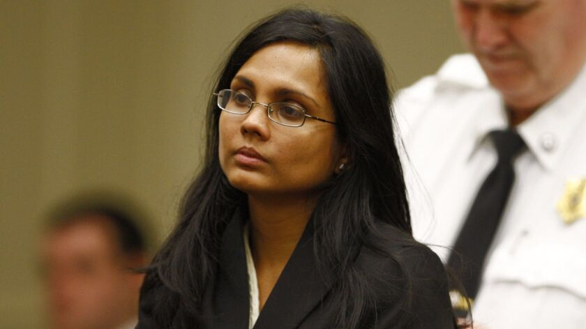 Annie Dookhan, a former chemist at the Hinton State Laboratory Institute, listens to the judge durin