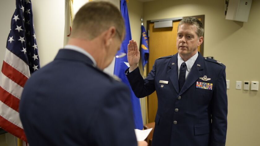 U.S. Air Force Lt. Col. Sean Navin, 144th Fighter Wing vice commander, was promoted to the rank of C