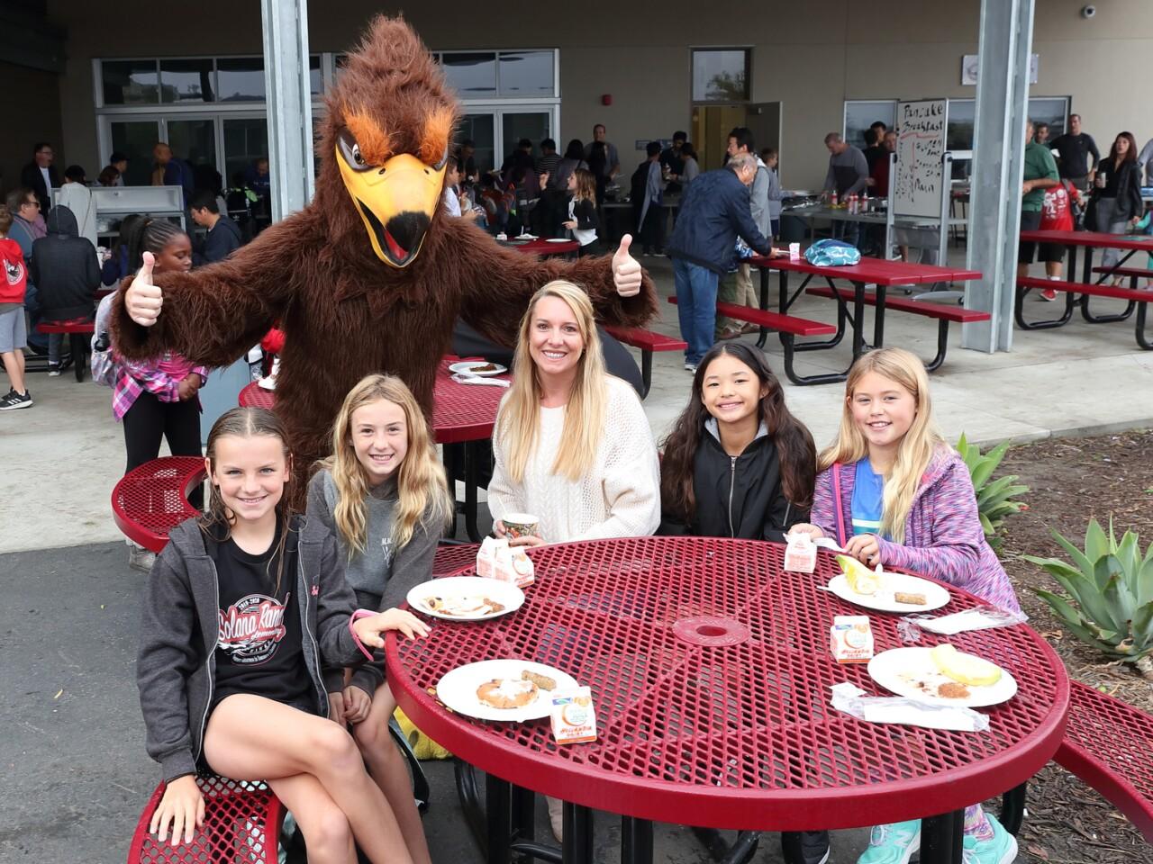 The Hawk mascot joins Madeline McCallion, Taylor Ehlers, Heather Balaban, Kylie Clark, Allison Newson