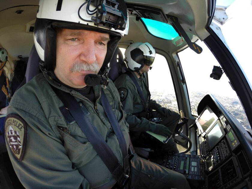San Diego Police Department helicopter pilot Kevin Means, left, worked his last day on Dec. 20, 2013. After almost 32 years on the force, he has retired. Officer Matt Zdunich, right, was serving as the tactical flight officer for this flight.