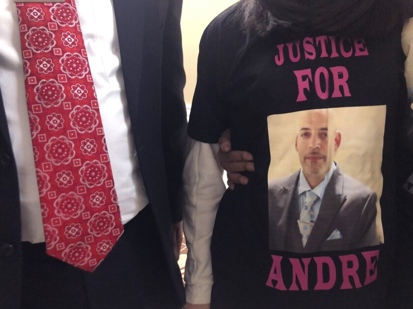 FILE - In this Dec. 31, 2020, file photo, Andre Hill, fatally shot by Columbus police on Dec. 22, is memorialized on a shirt worn by his daughter, Karissa Hill in Columbus, Ohio. Former Columbus Police officer Adam Coy was charged with murder in the shooting death Andre Hill, a Black man. Assistant Attorney General Anthony Pierson filed a motion Wednesday, July 14, 2021, opposing Coy's request for the trial be moved to another county in order to convene a fair and impartial jury. (AP Photo/Andrew Welsh-Huggins, File)