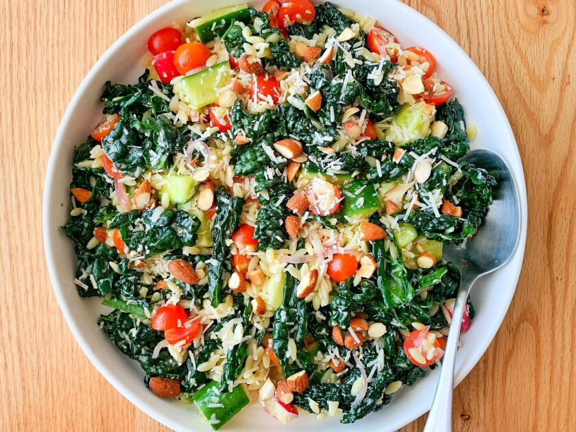A kale salad with pasta, Parmesan and smoked almonds