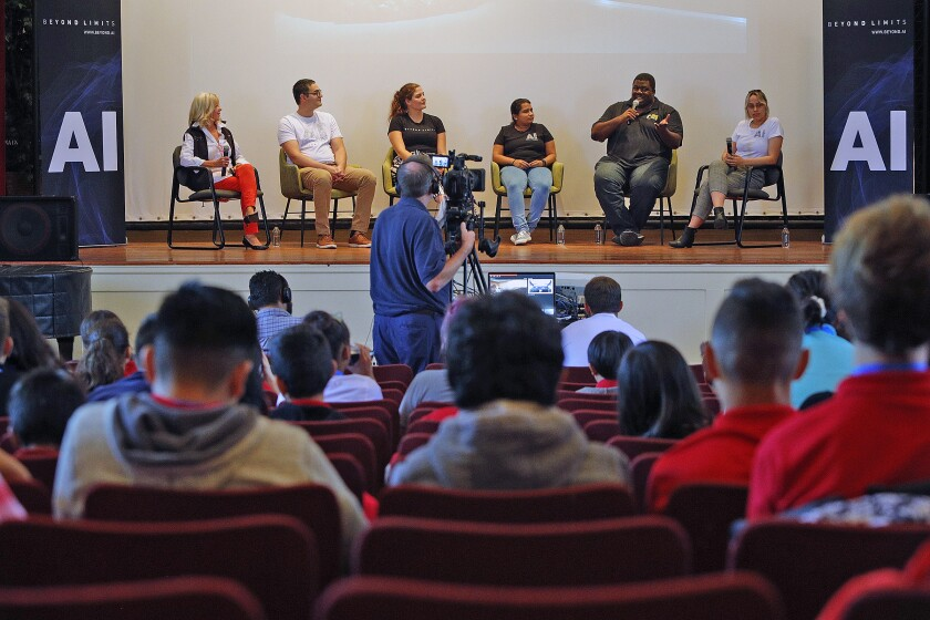 Diane Zuckerman, from left, Giovanni Genitile, Nicole Thompson, Shreya Wagel, Uche Akotabi and Laura Marsh from Beyond Limits speak on a panel held at Roosevelt Middle School on Monday about artificial intelligence as part of Glendale Tech Week.
