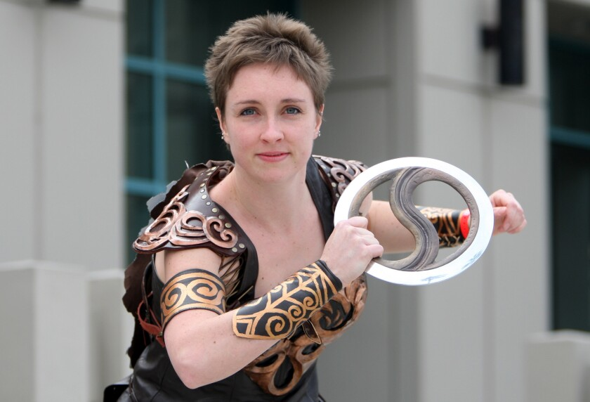 Cosplayer Lauren Saalmuller, 24 of Boston, srrikes a pose as Xena the princess warrior, at the Xena Warrior Princess 20th Anniversary Celebration, The Absolute Last Official Xena Convention: The Bittersuite Finale at the Burbank Marriott Convention Center in Burbank on Friday, Feb. 20, 2015. The convention continues through the weekend.