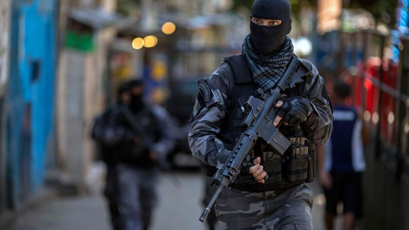 Members of the Brazilian military police special unit Choque patrol during an operation in the Rocinha favela in Rio de Janeiro on Monday.