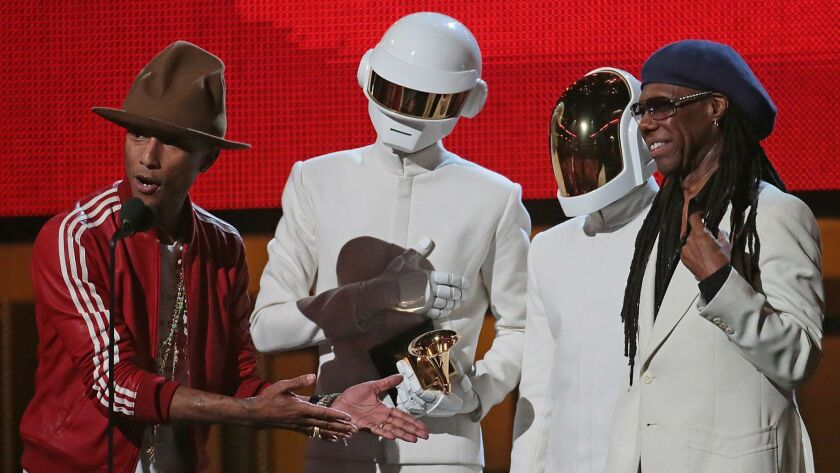LOS ANGELES, CA - January 26, 2014 L/R Pharrnell Williams, Daft Punk duo, and Nile Rodgers on stage