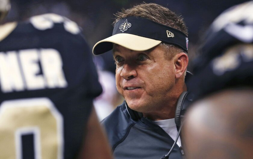 New Orleans Saints head coach Sean Payton counsels his players on the sideline in the first half of an NFL football game against the New York Giants in New Orleans, Sunday, Nov. 1, 2015. (AP Photo/Jonathan Bachman)
