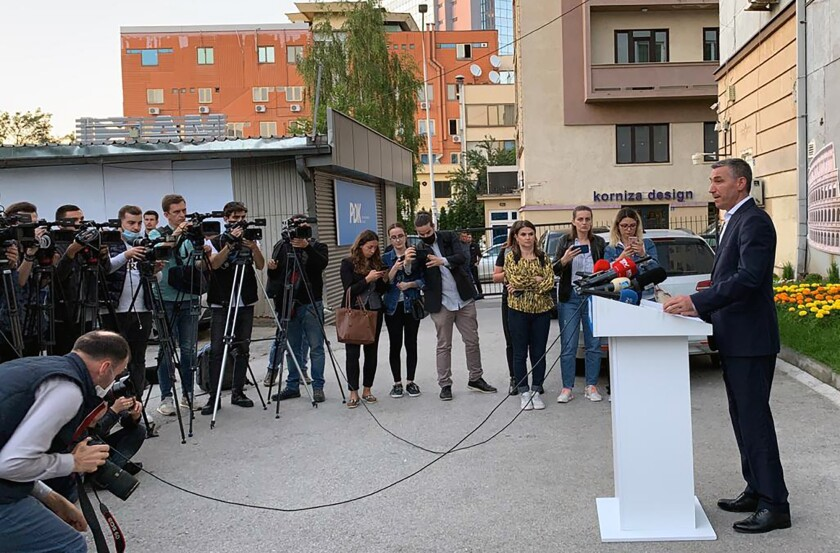 Kadri Veseli speaks in Pristina, Kosovo's capital, on June 24, 2020, after his indictment on war crimes charges.