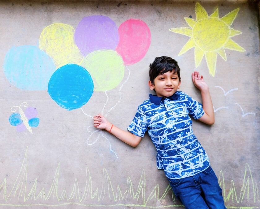 Samarth Joshi with his drawing that received second place in the elementary division.