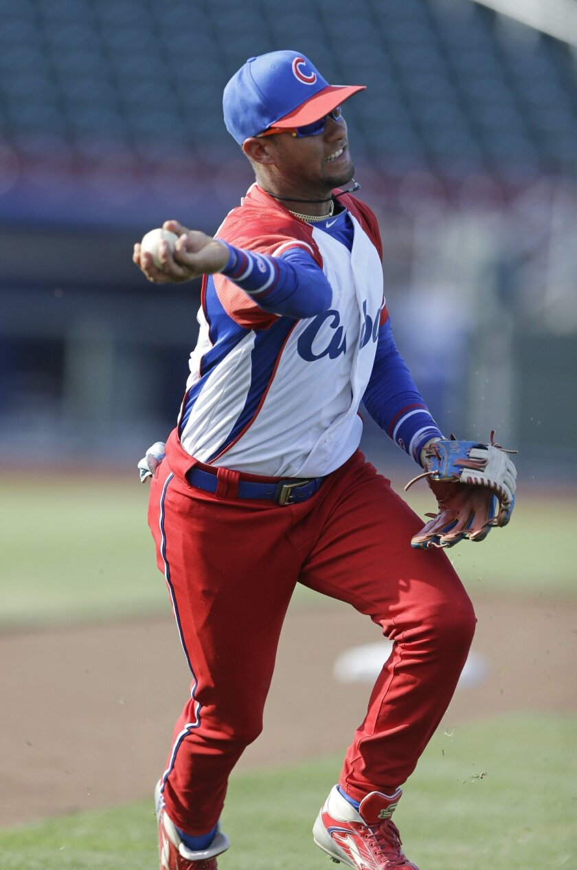FILE - In this July 19, 2013 file photo, Cuba third baseman Yulieski Gourriel warms up prior to an exhibition baseball game against the United States in Papillion, Neb. A baseball official in the Dominican Republic said on Monday, Feb. 8, 2016, that Gourriel has abandoned his team at the close of t