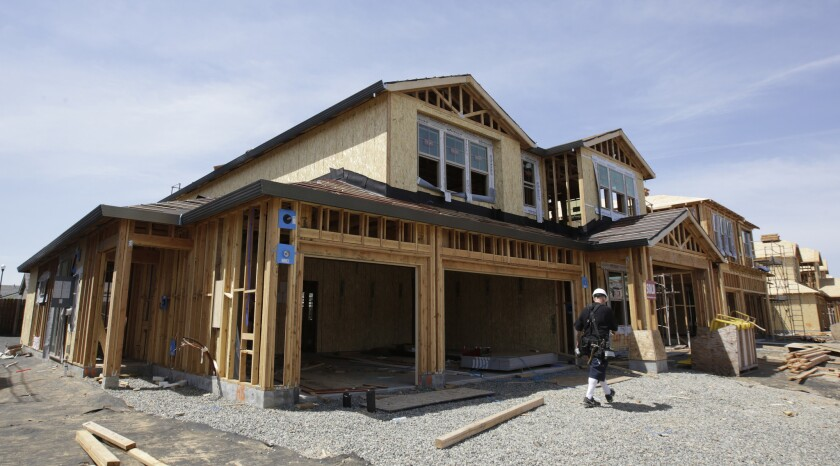FILE- This May 4, 2018, file photo shows a house under construction in Roseville, Calif. On Thursday