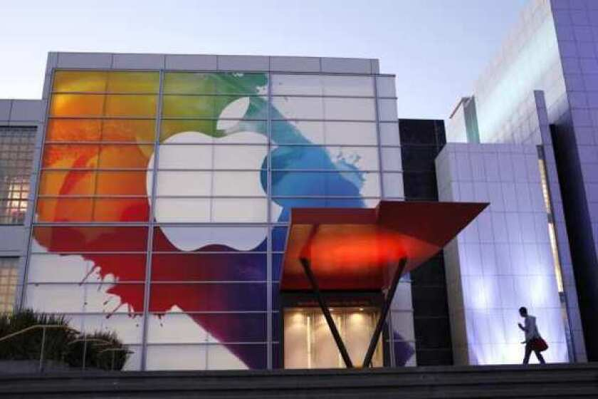 An Apple logo hangs above the entrance of Yerba Buena Center for Arts in San Francisco. The company is expected to unveil its newest iPhone on Wednesday.