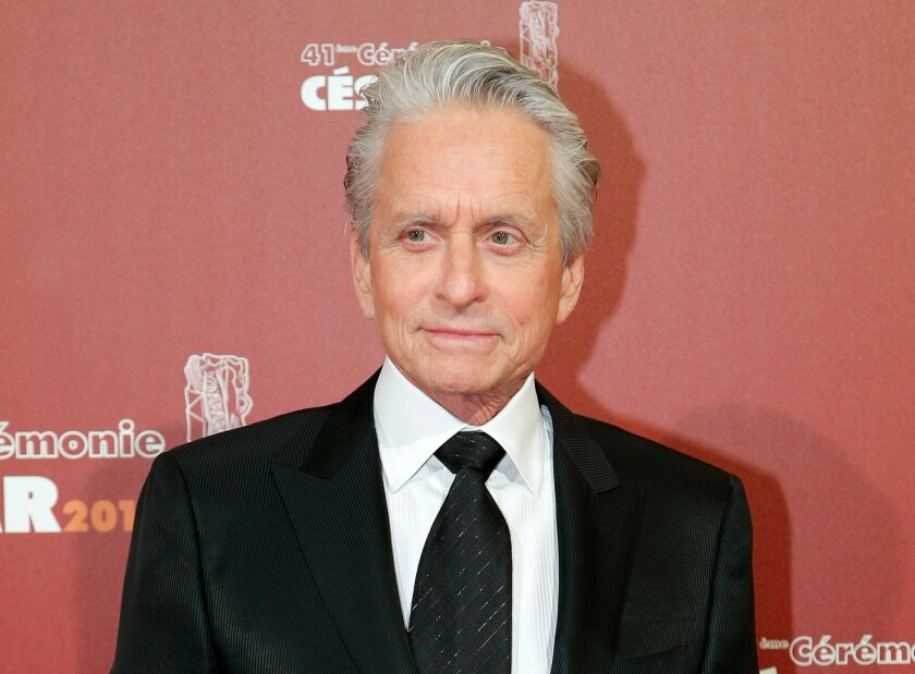 FILE - In this Feb. 26, 2016 file photo, U.S actor Michael Douglas arrives at the 41st French Cesar Awards Ceremony, in Paris. Douglas is donating his personal collection of more than three dozen film prints to Rochester's George Eastman Museum. Officials at the photography museum said Thursday, March 31, that the Douglas collection of 35 mm and 16 mm prints, 37 in all, includes more than 30 that he starred in or produced. (AP Photo/Thibault Camus, File)