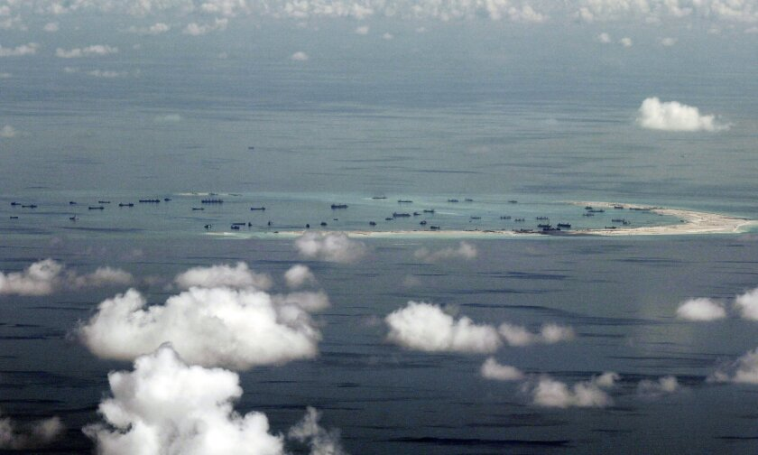 FILE - This May 11, 2015, file photo, shows land reclamation of Mischief Reef in the Spratly Islands in the South China Sea. An international tribunal has found that there is no legal basis for China's claiming rights to much of the South China Sea. The Permanent Court of Arbitration (PCA) issued i