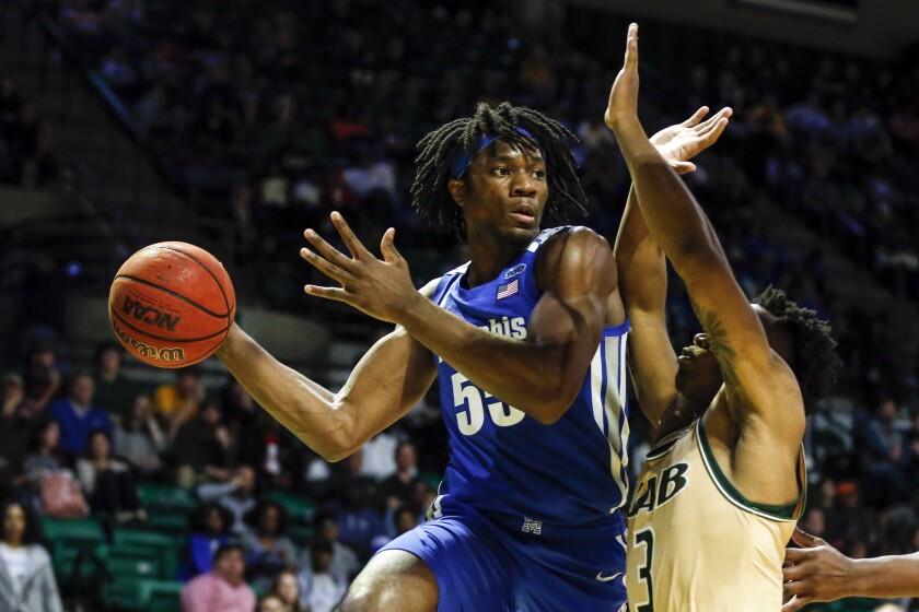 Memphis forward Precious Achiuwa (55) throws a pass as UAB guard Tavin Lovan (3) defends during the second half of an NCAA college basketball game Saturday, Dec. 7, 2019, in Birmingham, Ala. (AP Photo/Butch Dill)