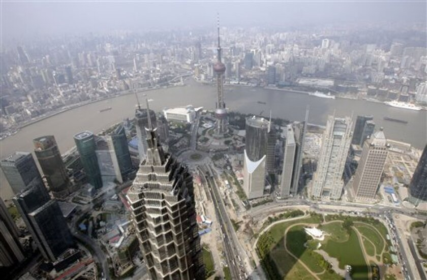 In this Oct. 21, 2008 file photo the city skyline is seen from the Shanghai World Financial Center in Shanghai, China, Tuesday Oct. 21, 2008. In the foreground is the Jinmao Tower, and at center the Oriental Pearl TV tower. China issued revised data for 2007 on Wednesday, Jan. 14, 2009, that showe