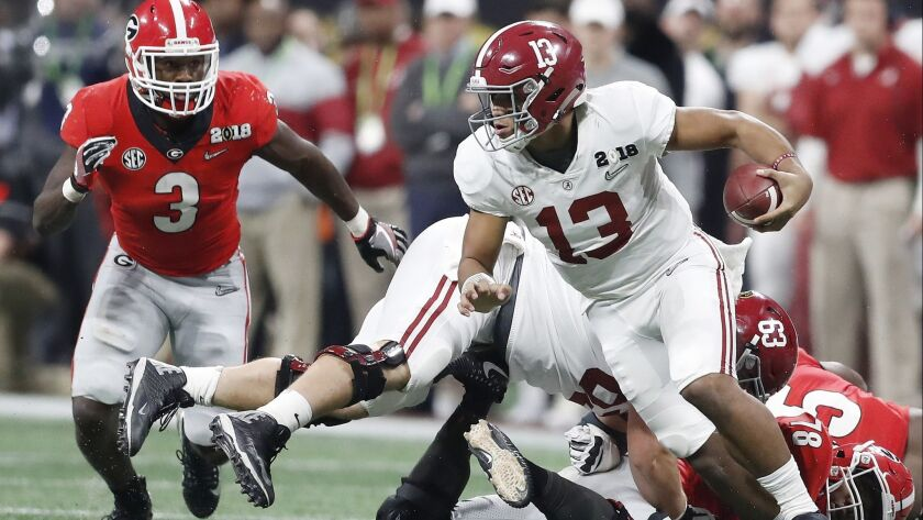 Alabama quarterback Tua Tagovailoa runs during the second half of the College Football Playoff championship game against Georgia in Atlanta on Jan. 8. The two teams will meet this Saturday in the Southeastern Conference championship.