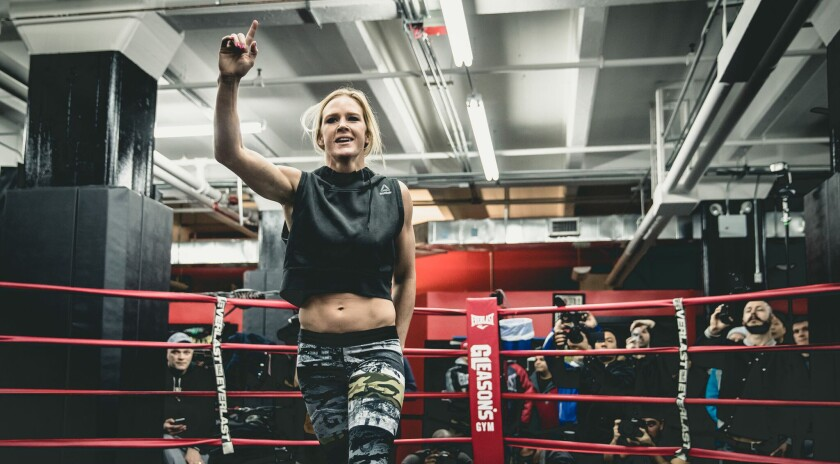 Holly Holm is all smiles after completing her workout in New York on Thursday. Holm lost her bantamweight title to Miesha Tate, who used a chokehold in the fifth round to earn the victory.