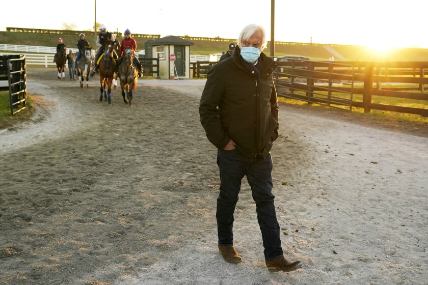 Bob Baffert walks through the stable area during morning workouts for the Breeders' Cup at Keeneland Race Course.