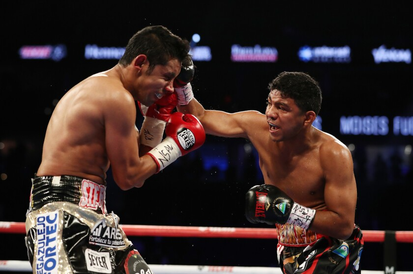 Roman Gonzalez punches Moises Fuentes during their super flyweight bout at T-Mobile Arena on September 15, 2018 in Las Vegas, Nevada.