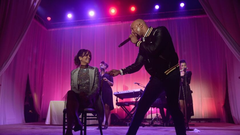 Halle Berry and Common perform onstage at the 16th Annual Chrysalis Butterfly Ball on June 3 in Los Angeles.