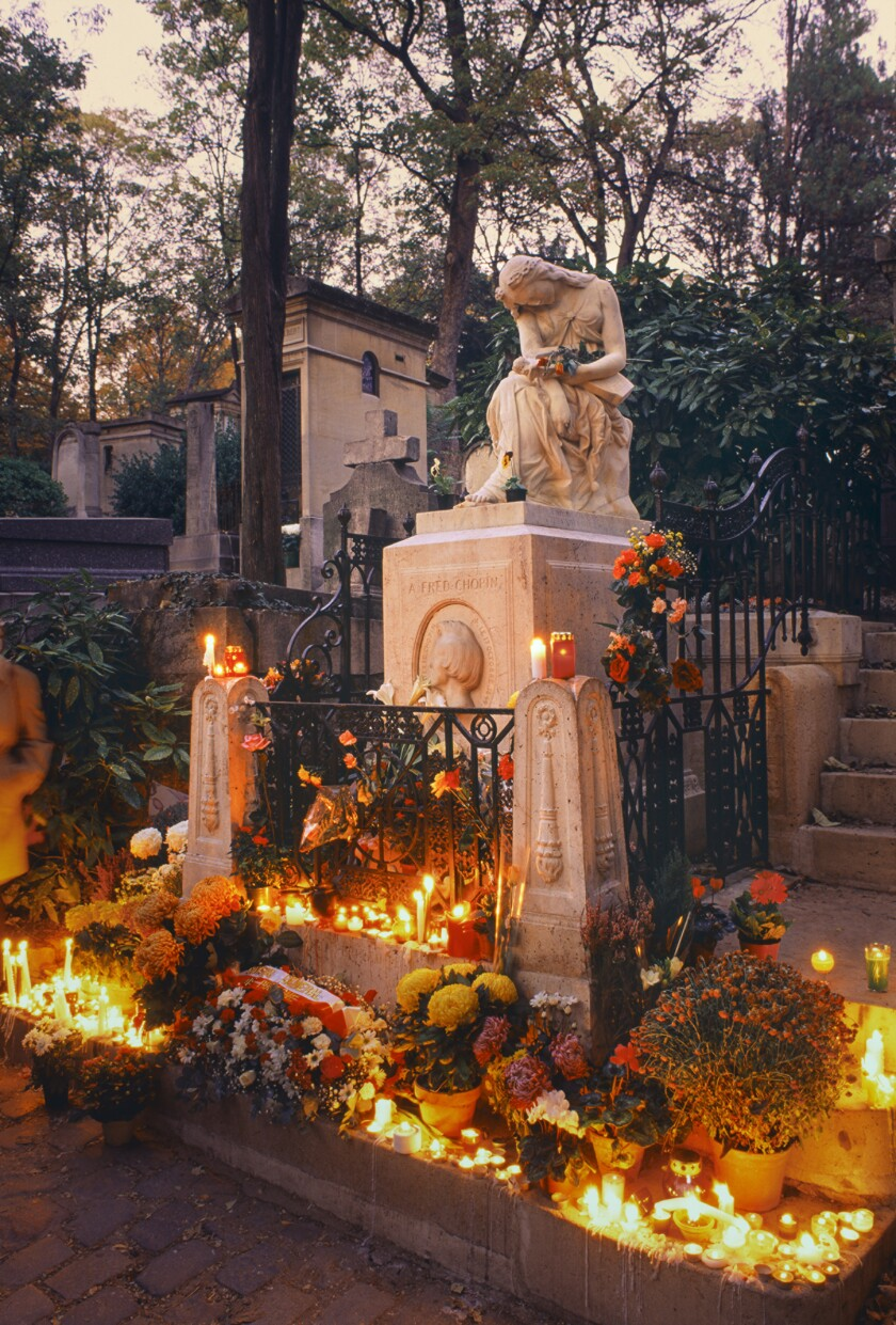 """City of Immortals"" includes the tomb of composer Frédéric Chopin, pictured at dusk on All Souls' Day."