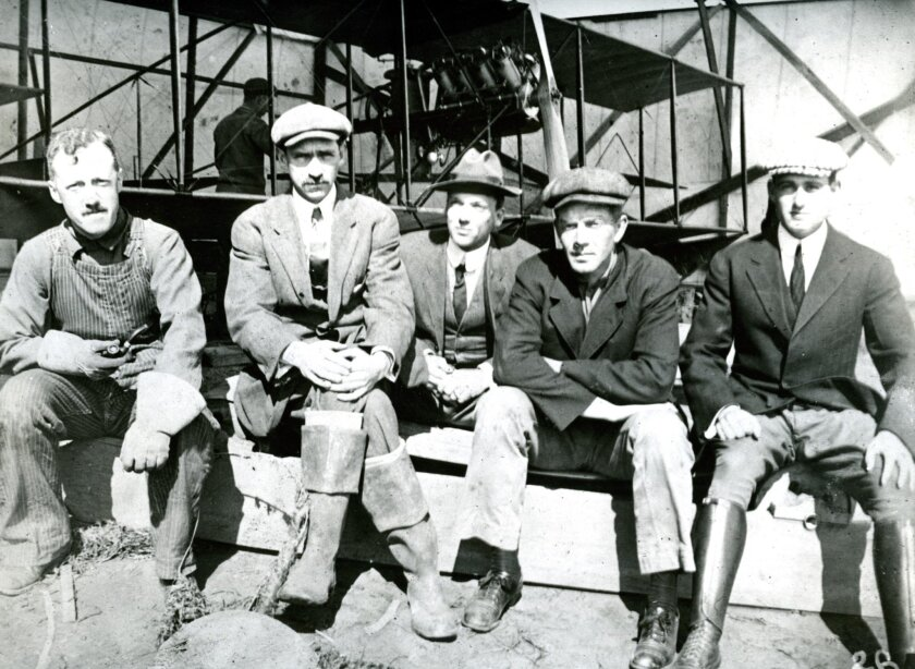 First U.S. military aviators.  From left: Lt. George E. M. Kelly, army; Glenn Curtiss; Capt. Paul M. Beck, army; Lt. Theodore G. Ellyson, navy; and Lt. John C. Walker, army. February 1911. U.S. NAVY PHOTO. Scanned from 8x10 print in UT archives.