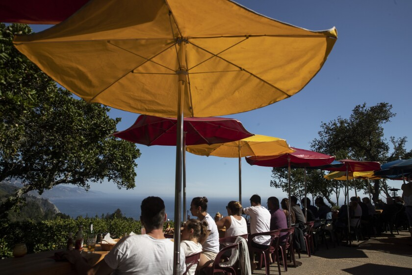 BIG SUR, CALIF. -- WEDNESDAY, AUGUST 1, 2018: Diners gather on a deck perched on a Big Sur cliffside