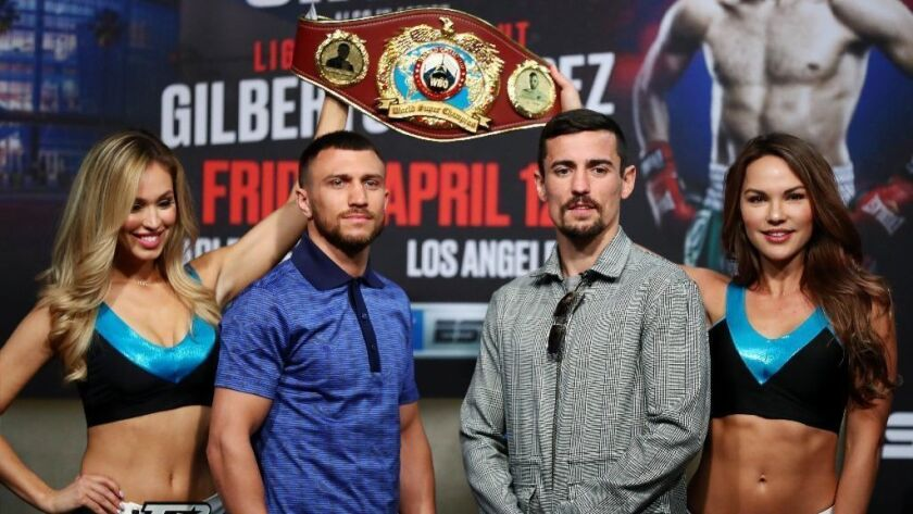 Vasiliy Lomachenko and Anthony Crolla pose for photos after the press conference ahead of their world lightweight championship fight at Staples Center on Wednesday