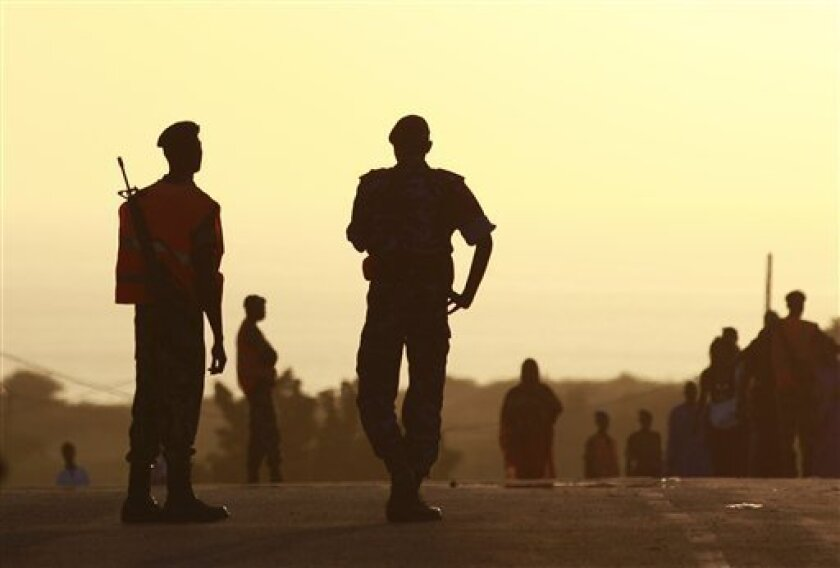 Senegalese soldiers stand guard at a ceremony welcoming a group of Haitian students to Dakar, Senegal Wednesday, Oct. 13, 2010. Senegal is one of the poorest countries in the world and its GDP is only marginally higher than Haiti's, but that didn't stop the government from going ahead with a plan t