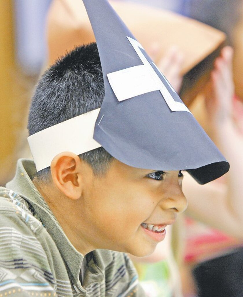 First-grader Jorge Mendoza wore his Pilgrim hat with his classmates during a program at Jefferson Elementary School in Carlsbad.