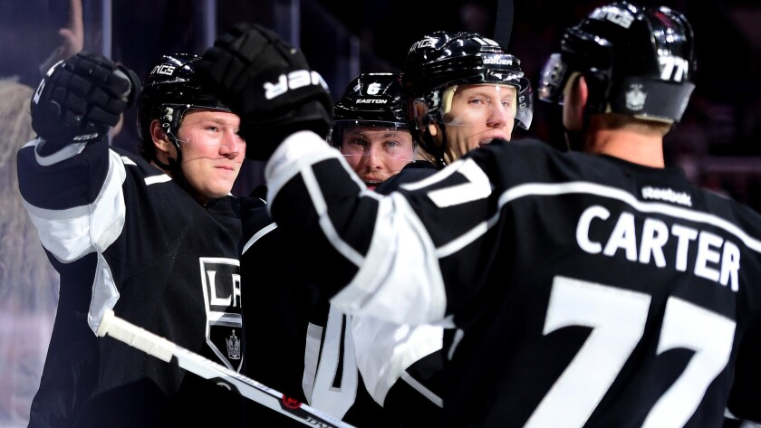 Kings center Tyler Toffoli, left, celebrates his goal against the Sharks in the first period with teammates Jake Muzzin, Christian Ehrhoff and Jeff Carter.