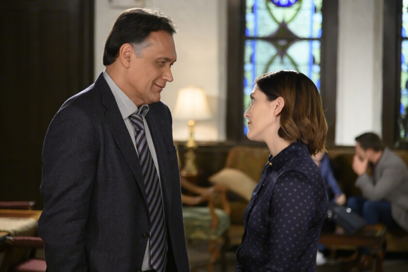 "Jimmy Smits and Caitlin McGee in a new episode of the courtroom family drama ""Bluff City Law"" on NBC."