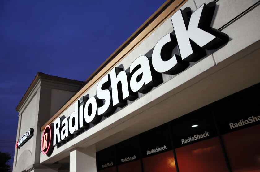 FILE - This Tuesday, Feb. 3, 2015 file photo shows a RadioShack store in Dallas. RadioShack, the nearly century-old electronics retailer ubiquitous in malls for decades, has been pulled from brink of death — again. It's the most prized name in the basket of retail brands that entrepreneur investors Alex Mehr and Tai Lopez have scooped up for a relative pittance since the coronavirus pandemic landed on U.S. shores. (AP Photo/Tony Gutierrez, File)