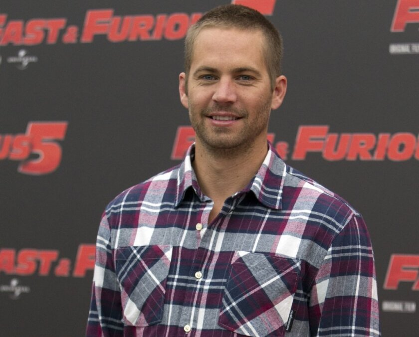 """Actor Paul Walker at screening of """"Fast and Furious 5"""" in Rome in 2011."""