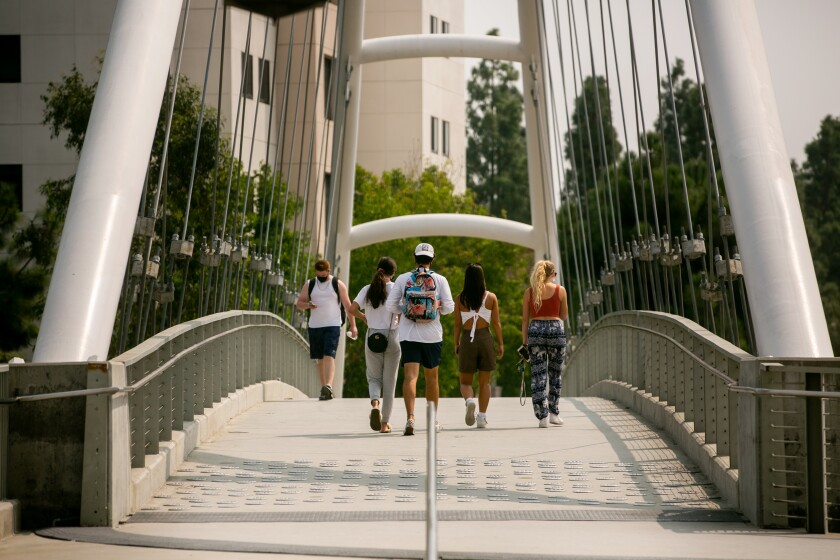 People walk across the campus of San Diego State University on Monday.